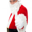 Happy Santa showing thumbs up to camera — Stock Photo #15658177