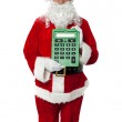 Old man dressed as Santa showing a large green calculator — Stock Photo #15658267