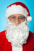 Snapshot of smiling senior man in Santa attire — Stock Photo
