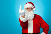 Agitated Santa showing his middle finger — Stock Photo