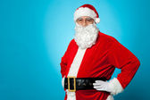Aged Santa posing with hands on his waist — Stock Photo