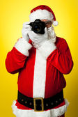 Smile please! Santa capturing a perfect frame — Stock Photo