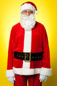 Isolated aged male dresses in Santa attire — Stock Photo
