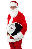 Aged male Santa holding weighing scale — Stock Photo