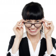Cheerful woman taking off her spectacles — Stock Photo #15690011