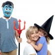 Young boy and cute girl participating in halloween celebration — Stock Photo