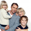 Family portrait of a couple with their two children — Stock Photo