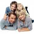 Adorable young kids piled on top of their parents — Stock Photo
