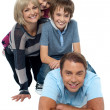 Fun loving family exhibiting great bonding — Stock Photo