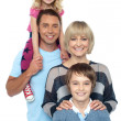 Portrait of happy family of four persons - Stock Photo