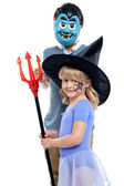 Young brother and sister in halloween costume — Stock Photo