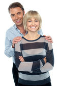 Lovely young couple portrait against white background — Stock Photo