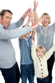 Jubilant family celebrating and partying indoors — Stock Photo