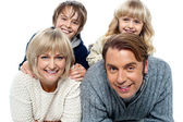 Spirited kids having fun with their parents indoors — Stock Photo