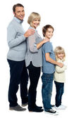 Full length family portrait of four members — Stock Photo