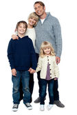 Cheerfully winter wear family of four. Stay protected — Stock Photo