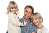 Cheerful family of three posing for camera — Stock Photo