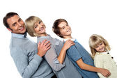 Cheerful family of four leaning backwards — Stock Photo