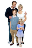 Indoor studio shot of lovely family, four members — Stock Photo