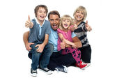 Cheerful thumbs up family — Stock Photo