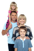 Portrait of happy family of four persons — Stock Photo