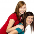 Mother piggybacks her teenage girl — Stock Photo #16896953