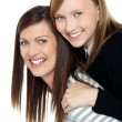 Pretty daughter enjoying a piggyback ride — Stockfoto