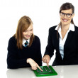 Teacher and student working on calculator — Stock Photo