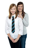 Blonde mother and daughter posing together — Stock Photo