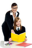 Teacher instructing student and helping her — Stock Photo