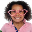 Pretty girl with a wide grin. Wearing funny frame — Stock Photo #16902241