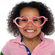 Stock Photo: Pretty girl with a wide grin. Wearing funny frame