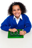 African elementary school kid using a calculator — Stock Photo