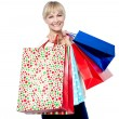 Vivacious woman holding colorful shopping bags — Stock Photo