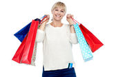 Portrait of a middle aged shopaholic woman — Stock Photo