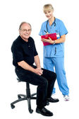 Pleasing doctor collecting patient's health history — Stock Photo