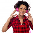Smiling woman with pink headphones on — Stock Photo