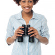 Smiling afro american woman holding binocular — Stock Photo
