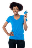 Beautiful female mode hlolding up cash card — Stock Photo