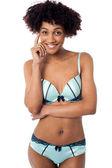 Sensuous young woman in bikini — Stock Photo