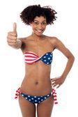 United States flag bikini model gesturing thumbs up — Stock Photo