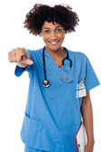 Smiling lady doctor pointing you out — Stock Photo