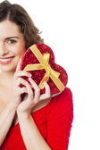 Cropped image of smiling woman holding present — Stock Photo