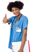 Happy lady doctor showing thumbs up sign — Stock Photo