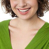 Cropped image of a woman flashing wide smile — Stock Photo