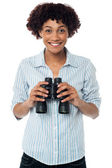 Smiling afro american woman holding binocular — Stock Photo