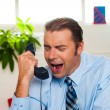 Businessman yelling during the phone call — Stock Photo