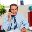 Smiling businessman attending work call — Stock Photo