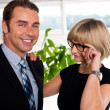 Secretary watching her boss closely while adjusting her glasses — Stock Photo