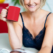 Pretty woman with a coffee mug in hand reading magazine — Stock Photo